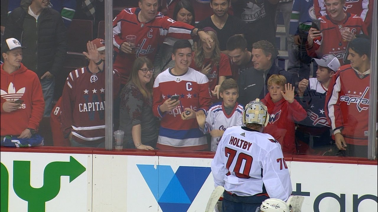 Holtby Not Amused As Adult Fan Takes Puck Away From Younger Capitals Fan Youtube