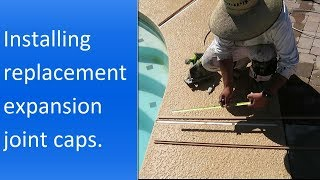 Installing replacement expansion joint caps in a concrete pool deck.