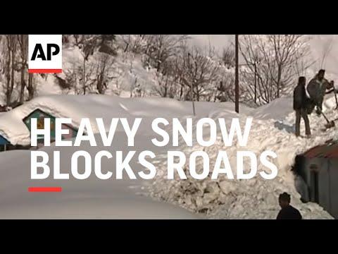 Heavy snow blocks roads and burries homes in disputed region