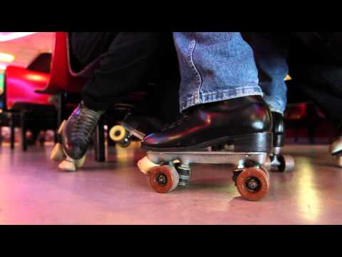Elderly couple passionate about roller skating