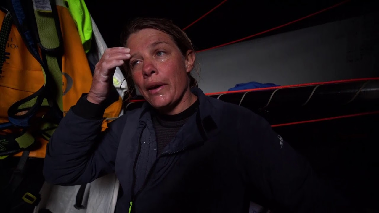 Brian in the hatch talks to the helm about Dongfeng and their course. He comes up and talks to Dee at the middle pedestal. Bianca, below, talks about it being frustrating that they don't have the pace the others have. Liz: Always more stressful when you have all the boats around you. Right at this moment we're going pretty bad, so it's been a pretty stressful 4 hours... We're getting overtaken... Bagging a sail on the foredeck. Ratcheting down the stack. Bianca, sounding emotional (or a little seasick. But I think probably just emotional): We've come close to getting podium finishes. Frustrating... As a team we've grown so much. We came together really late, and we've dedicated 10 months of our lives to trying to sail with each other. Really want a podium finish. Failing that, we want to get a couple of boats between us and Scallywag to move up in the standings. It's been fantastic sailing with this lot. And it's kind of sad coming so closely to an end. Have to make the most of these last two legs, because this might be the last time we all sail with each other. But it's been awesome. They're all family now. Bianca sprays water on Liz, then on herself. Helmsperson raises his/her arms. Liz, below: Going pretty good. Gonna be a pretty tough night. Washing machine shot through the hatch. Grinding. Liz: Finishing the race with Scallywag behind us... I don't wanna come last. We don't deserve to come last. We've been quicker on the water; just maybe haven't had as much luck.