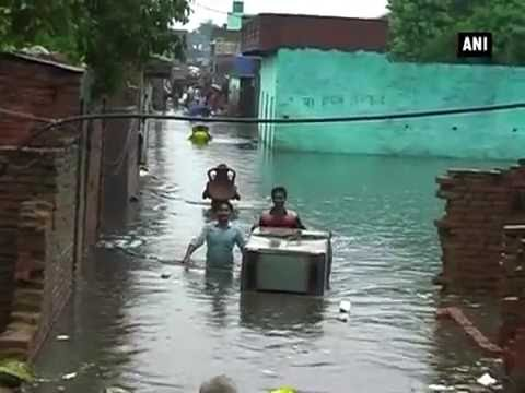 Rain water enters residential areas in Aligarh - ANI News