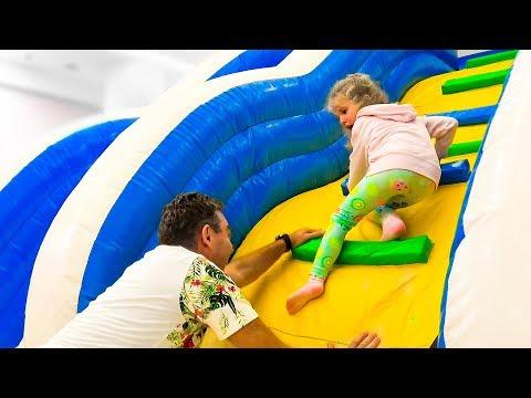 Milusik and papa family playtime on the playground