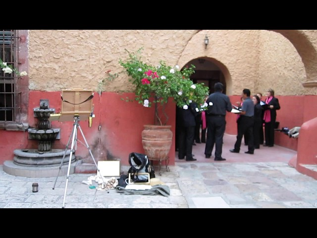 More painting in the church courtyard, San Miguel de Allende Mexico.