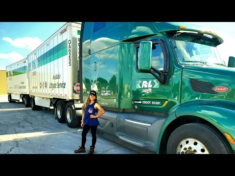 Filipina/Female Truck Driver Connecting Double Trailers