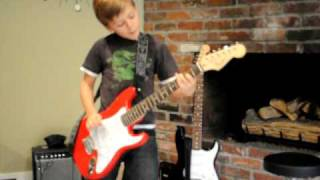 6 yr old plays ac dc back in black on guitar