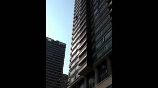 Crazy man goes bezerk on the 17th floor, will he jump????