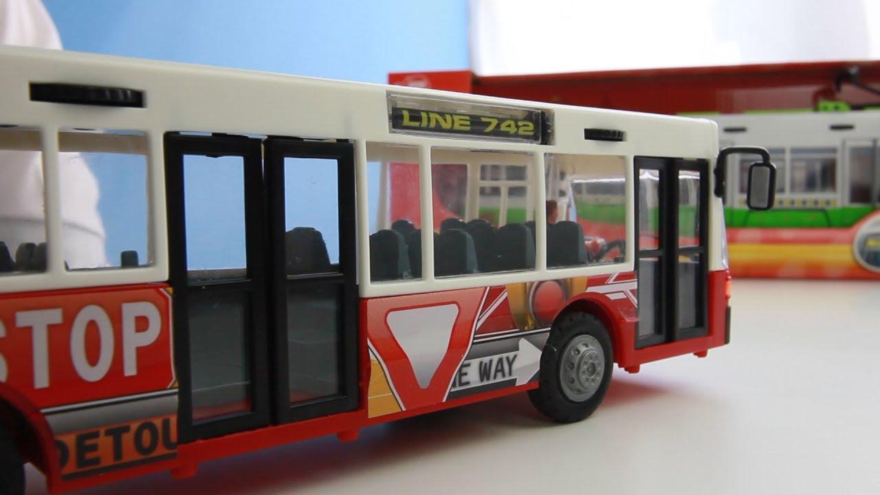 Открываем игрушки машинки. Городской автобус с гармошкой ...