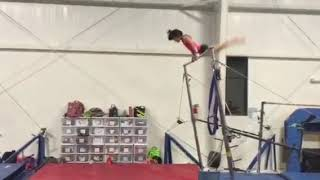 Girl Gymnast Performs Double Back Dismount on Uneven Bars - 1025618-6