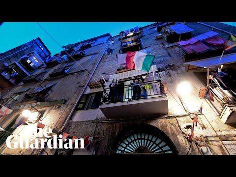 Coronavirus: quarantined Italians sing from balconies to lift spirits