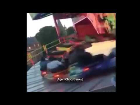 Guy Standing On Carnival Ride - Round and Round