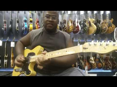 Playing a Fender Telecaster at Guitar Center in Las Vegas, Nevada.