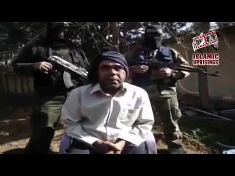 Syrian rebels captured assad shabih helps assad soldiers on barrier