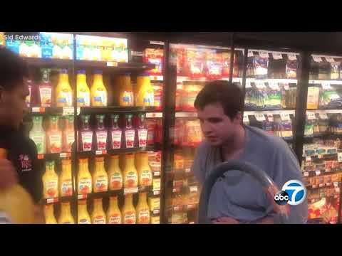SWEET VIDEO: Grocery store worker lets teen with autism help him restock shelves | ABC7