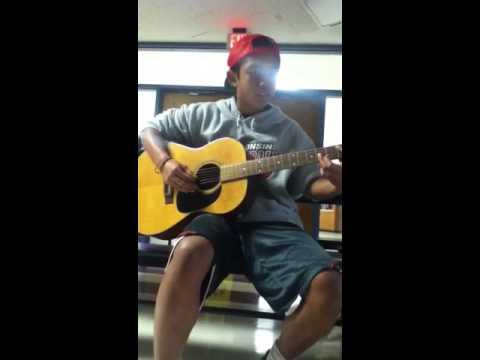 Cute Boy Playing Amazing Guitar