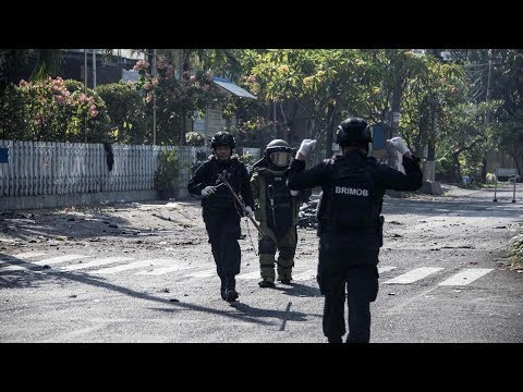 Suicide bombers attack Indonesian churches, killing at least nine and wounding 40