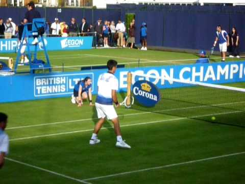 Novak Djokovic playing doubles at Queen