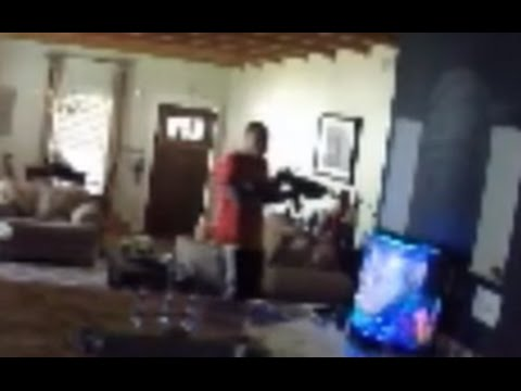 robber With AK47 Caught on a Home Security Camera