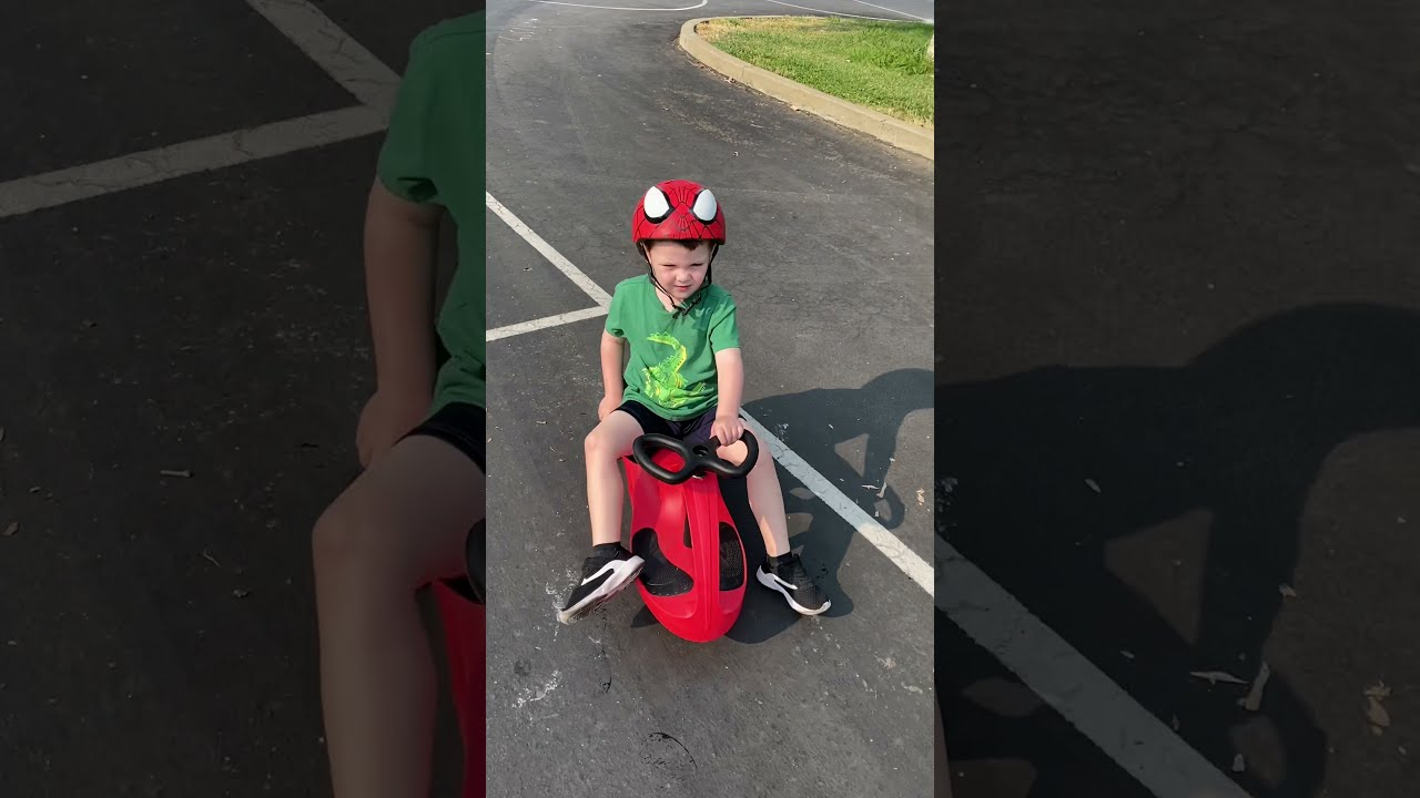 Wyatt and Jack riding wiggle cars
