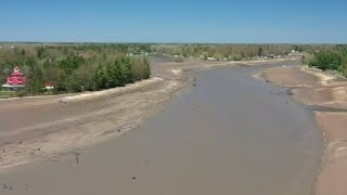 Wixom Lake becomes muddy field after dam failures