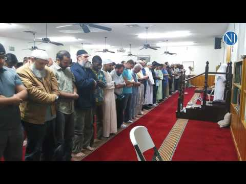 Worshippers at the Islamic Center of Daytona Beach participate in evening prayers Sunday night insid