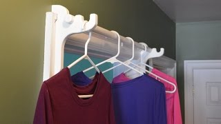 A Bar For Hanging Clothes To Dry In A Door Frame