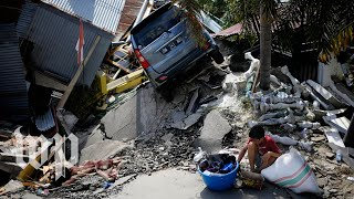 Days after tsunami, Indonesians are critical of recovery effort
