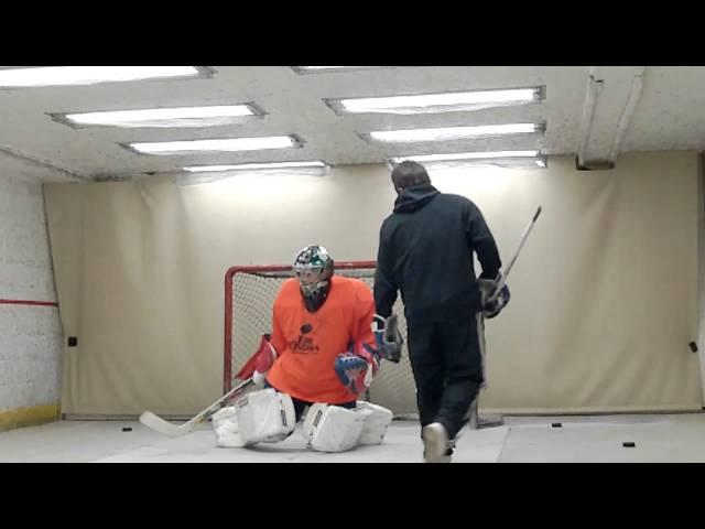 Goalie training before the start of college hockey