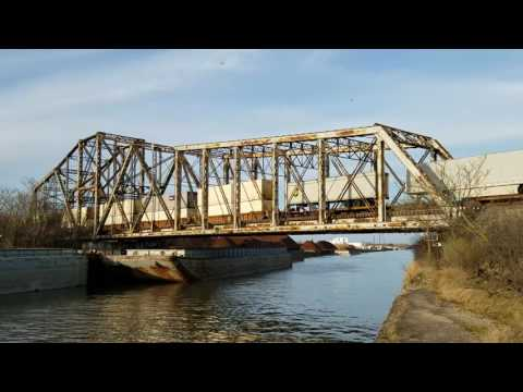 Freight train rolls across 1893 Chicago ship and sanitary canal bridge
