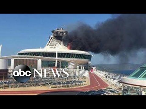Burning Cruise Ship Arrives Into Jamaican Port