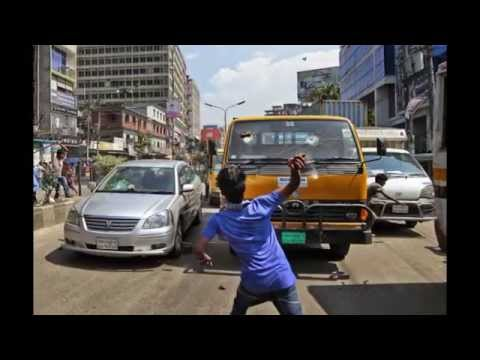 Bangladeshi police chase away garment workers as they clash in Dhaka,