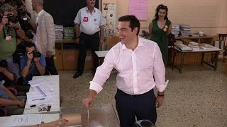 Greek voters decide euro future in too-close-to-call poll