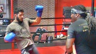 Bellator star Noad Lahat padwork with trainer Dewey Cooper