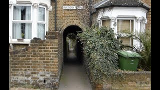 RARE Alley to a railway foot crossing in London