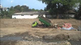 Dump Truck Hyundai Unloading Dirt after get Stuck in the Sand
