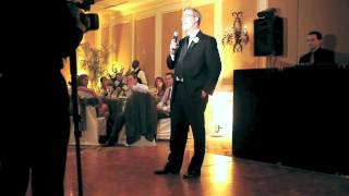 Howie gives a toast to the bride and groom.