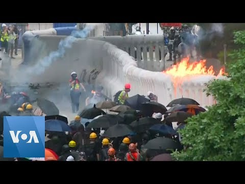 Police Fire Tear Gas and Water Cannons as Hong Kong Protests Erupt