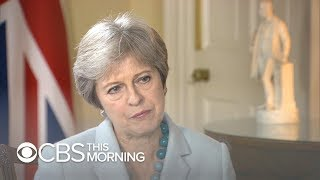 British Prime Minister Theresa May says she trusts President Trump