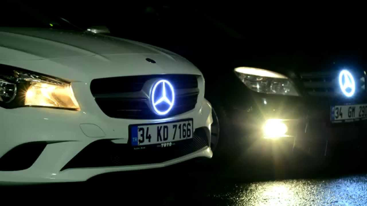 Mercedes lighted logo emblem youtube for Mercedes benz symbol light