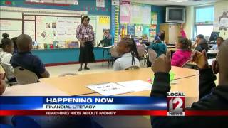 Young students learning financial responsibility in school