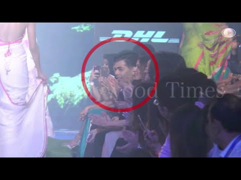 Karan johar checking out Gauri Khan's Assets at LFW 2015