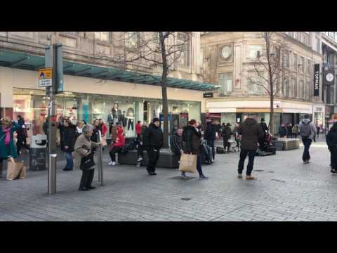 Lady dances to street entertainers