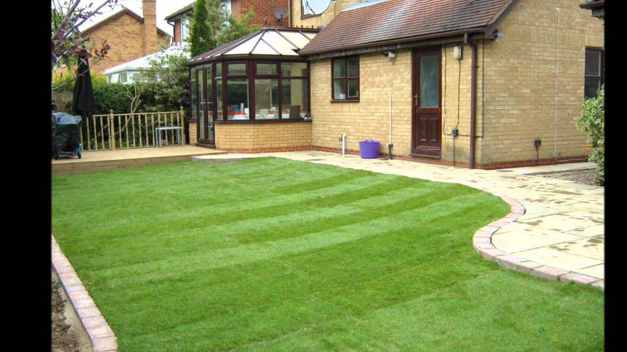 Decking, patio, turf and brick edging laid. - YouTube