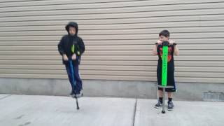 Teaching my little brother how to POGO STICK