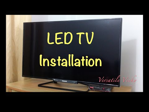 How to Install / Fix / Attach LED TV Table Top Stand  DIY How to Install a TV Stand