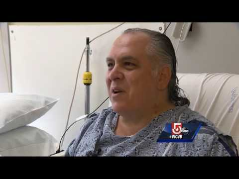 Boston patient playing saxophone with heart while waiting for a new one