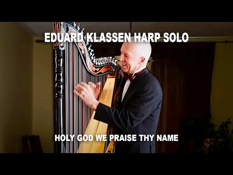 "Eduard Klassen with the song ""Holy God we praise thy name""."