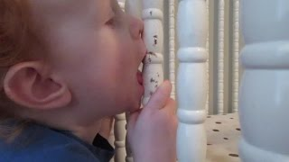 Baby Bites His Way Thru Crib