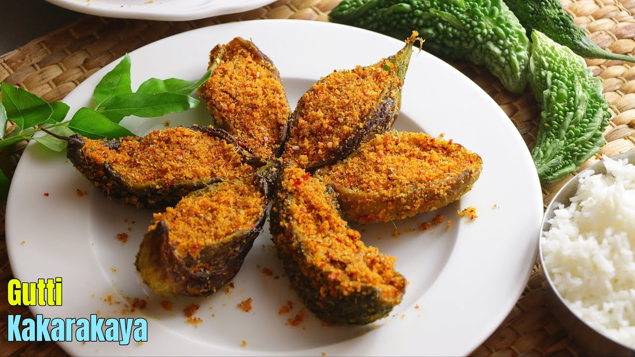 గుత్తి కాకరకాయ   Stuffed Bitter Gourd curry Recipe by Vismai Food in Telugu    Stuffed Karela