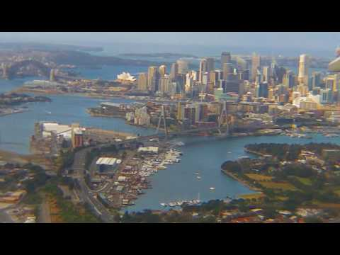 Sydney window view landing via eastern suburbs and upper north shore — SYD 16R